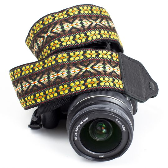 Yellow / brown hootenanny camera strap.