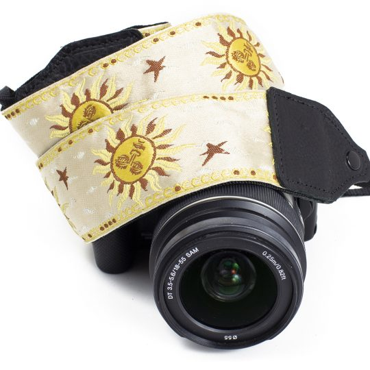 Cream / yellow sun jacquard camera strap.