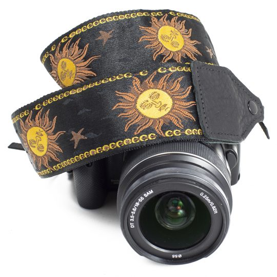 Black / yellow sun jacquard camera strap.