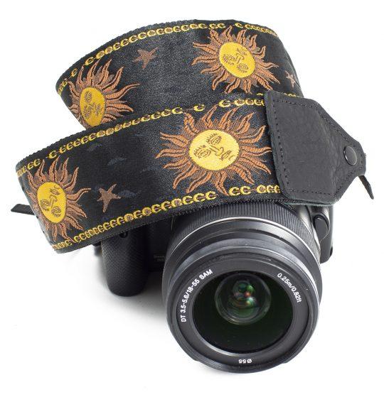 Black / yellow sun jacquard camera strap.