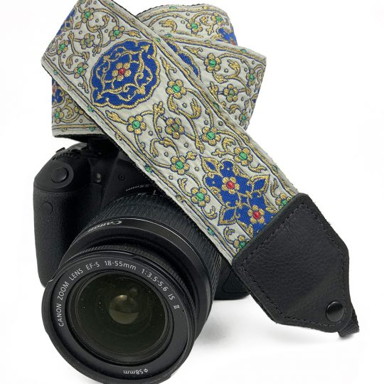 Gold floral trail jacquard camera strap.