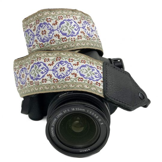Purple / cream geo floral jacquard camera strap.