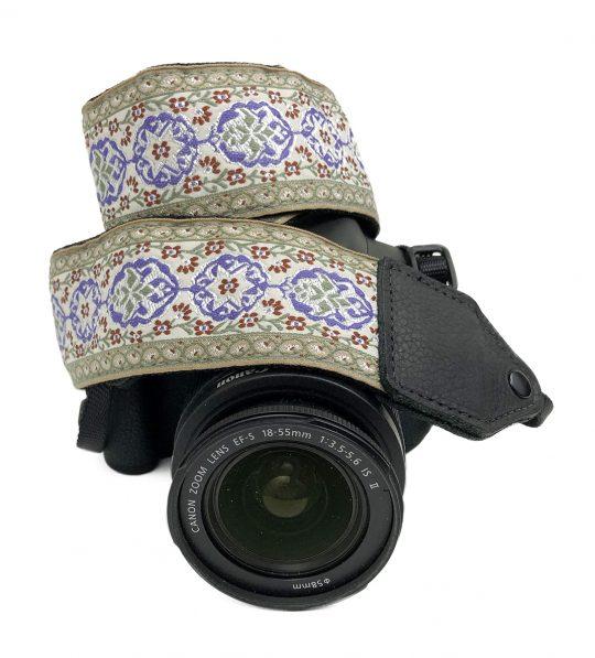 Purple / cream geo floral jacquard camera strap.
