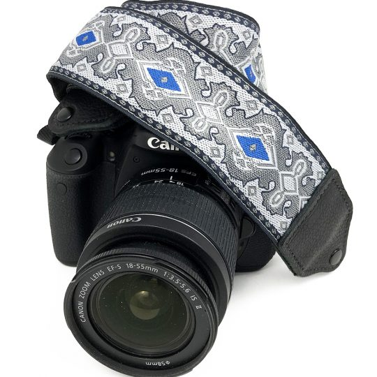 Silver / blue diamond jacquard camera strap.
