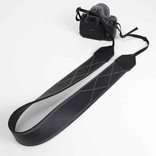 Black / white stitched leather camera strap.