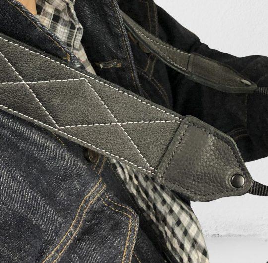 Black / white stitched leather camera strap.