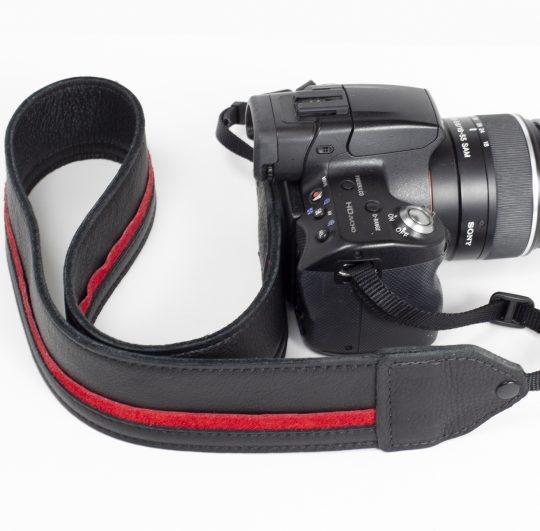 Black / red racing stripe leather camera strap.