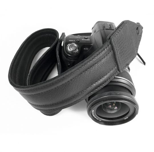 Black piped leather stitch camera strap.