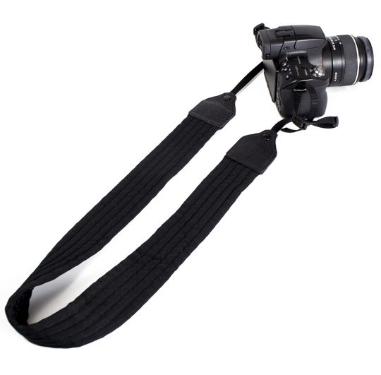 Black pleated nylon camera strap.
