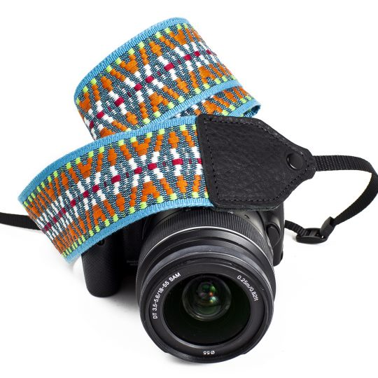 Turquoise / orange nylon geo camera strap.