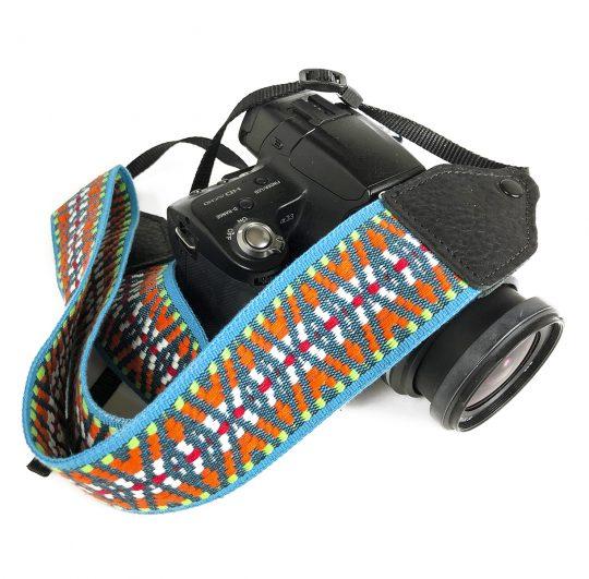 Turquoise / orange nylon geo camera strap.