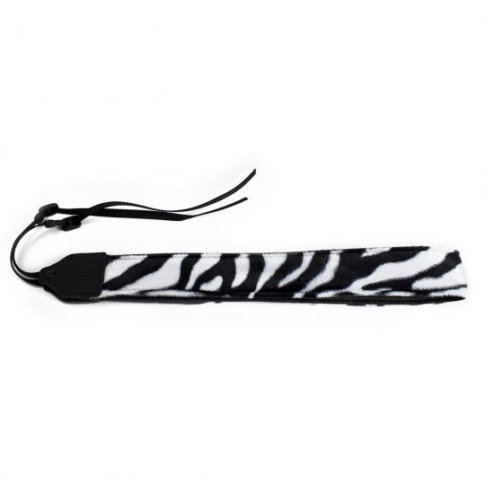Black / white zebra faux fur camera strap.