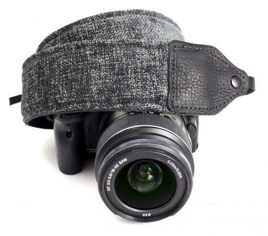 Gray wool camera strap.