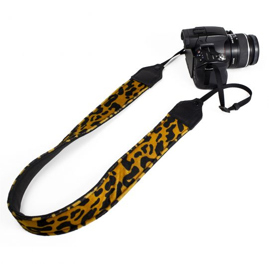 Gold / black leopard faux fur camera strap.
