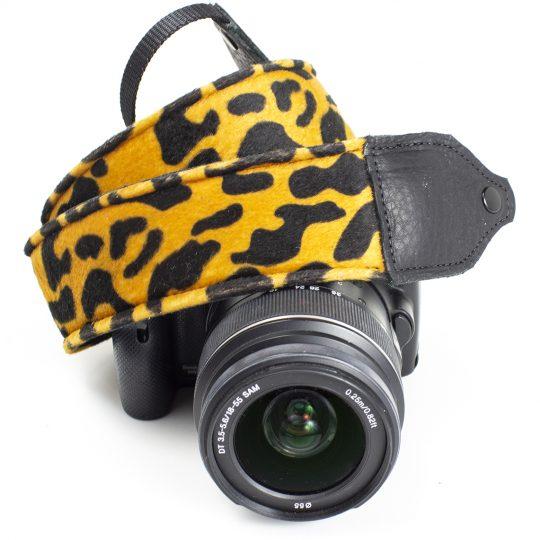 Gold / black animal print faux fur camera strap.