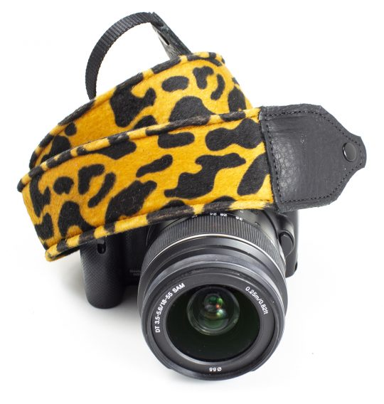 Gold / black animal print faux fur camera strap.